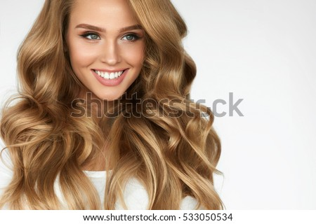Beautiful Curly Hair. Smiling Girl With Healthy Wavy Long Blonde Hair. Portrait Happy Woman With Beauty Face, Sexy Makeup And Perfect Hair Curls. Volume, Hairstyle, Hairdressing Concept. High Quality #533050534