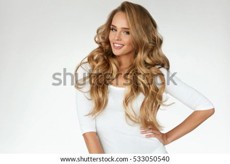 Beautiful Curly Hair. Smiling Girl With Healthy Wavy Long Blonde Hair. Portrait Happy Woman With Beauty Face, Sexy Makeup And Perfect Hair Curls. Volume, Hairstyle, Hairdressing Concept. High Quality #533050540