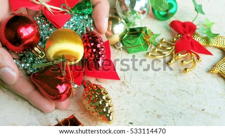 New year and Christmas decorations in hand #533114470