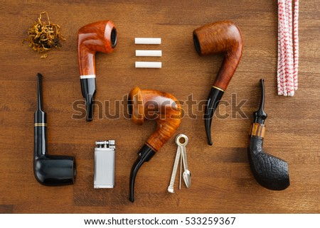 Collection of pipes and pipe smoking utensils #533259367