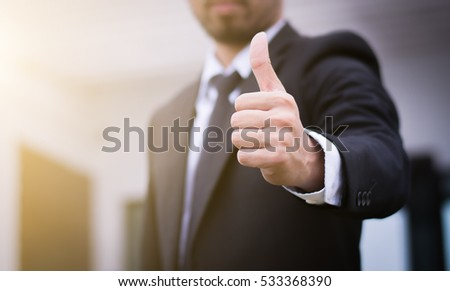 Businessman showing thumbs up - closeup shot #533368390