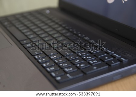 Laptop keyboard close-up, focus enter key #533397091