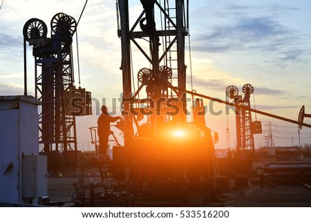 field oil workers at work #533516200