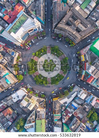 Road roundabout with car lots in the city in Thailand.Sixth Street intersection is beautiful.city scape. Light evening.Aerial view. transportation. #533632819