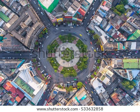Road roundabout with car lots in the city in Thailand.Sixth Street intersection is beautiful.city scape. Light evening.Aerial view. transportation. #533632858