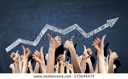 Group of people rise hands . Mixed media Royalty-Free Stock Photo #533644474