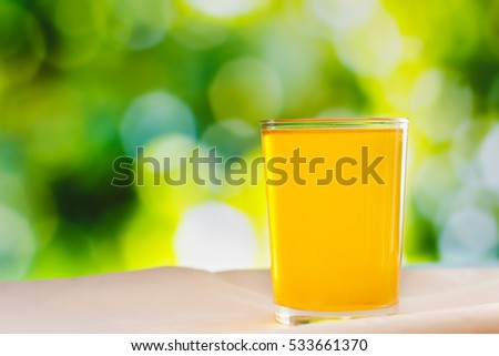A glass of oral rehydration salts ( electrolyte drink ) with nature bokeh background
