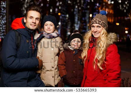Smiling family with children outdoors #533665393