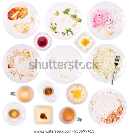 Dirty plates and cups after a meal isolated on white background #533699413