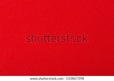 Bright red felt rough texture. High resolution photo.