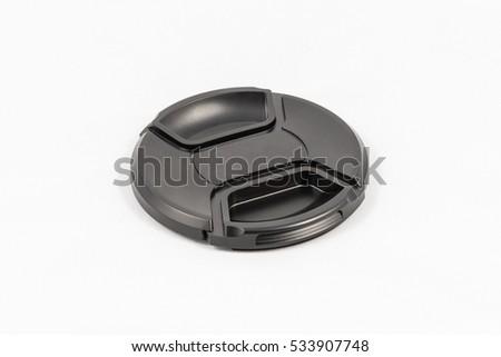 Black unbranded DSLR lens cap, isolated on white background #533907748