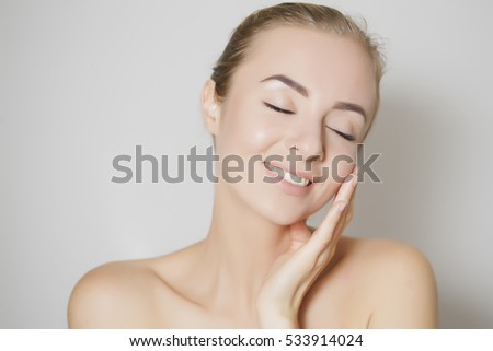 woman removing old skin from her fsce #533914024