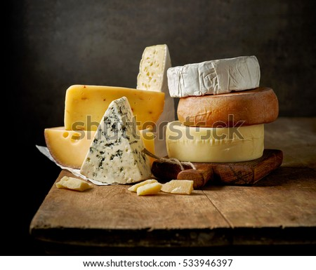 various types of cheese on rustic wooden table #533946397