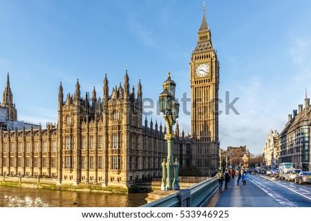 Big ben clock tower in winter sunny morning, London Royalty-Free Stock Photo #533946925