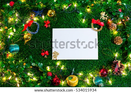 Christmas day on green grass and copy space. Morning sunshine day and good day.Happy time together in winter season.Textures background top view.