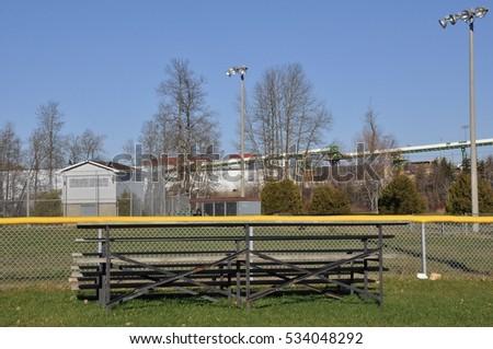 Back of old wooden bleachers in sports field #534048292