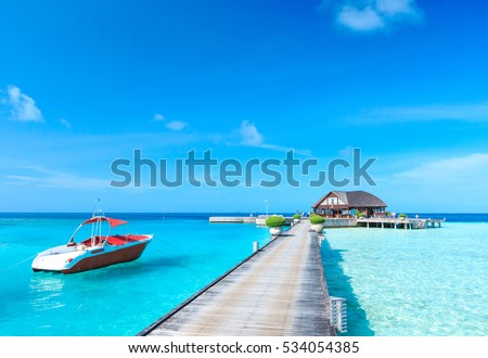 beach with water bungalows at Maldives #534054385