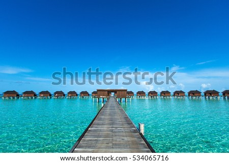 beach with water bungalows at Maldives #534065716