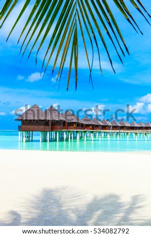 Beautiful beach with water bungalows at Maldives #534082792