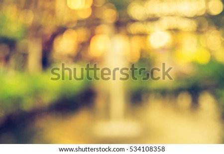 Abstract Blurred background image of Fountain with bokeh in evening time . (vintage tone) #534108358