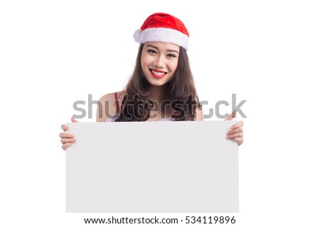 Asian Christmas girl with Santa Claus clothes holding blank sign isolated on white background #534119896