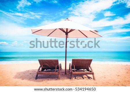 Beautiful beach. Chairs on the  sandy beach near the sea. Summer holiday and vacation concept. Tropical beach. #534194650