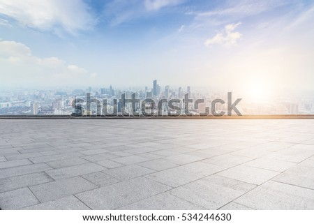 Panoramic skyline and buildings with empty concrete square floor #534244630