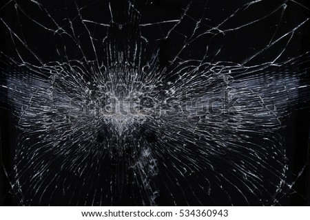 macro texture background broken glass with radial cracks on a black background  #534360943