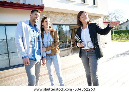 Couple with real-estate agent visiting house for sale #534362263
