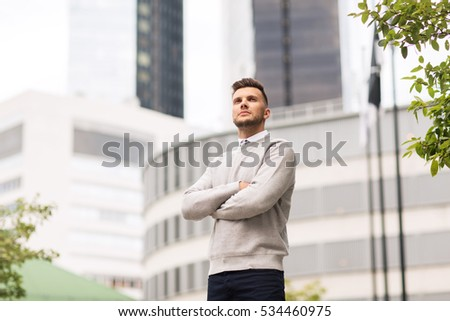 business and people concept - young man on city street #534460975