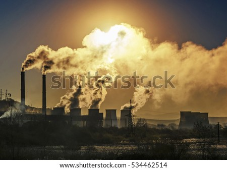 Factory pipe polluting air, smoke from chimneys against sun, environmental problems, ecological theme, industry scene Royalty-Free Stock Photo #534462514