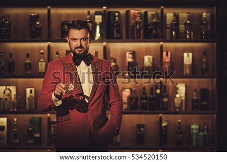 Extravagant stylish man with whisky glass in gentleman club #534520150