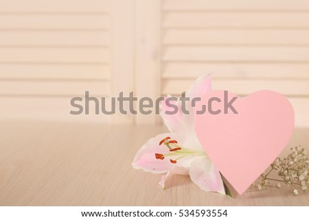 Valentines day heart shaped card and flowers on wooden background #534593554