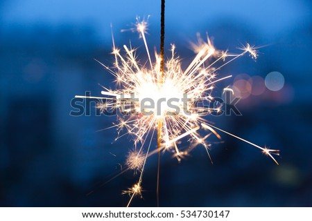Christmas and newyear party sparklers in the dark #534730147