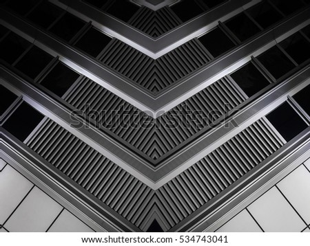 Digitally composed photo of louvered window corner. Realistic but fictional industrial or office architecture fragment. Abstract black and white background image on the subject of modern interior. #534743041