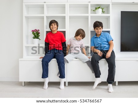 Happy children having fun and posing in new modern home #534766567