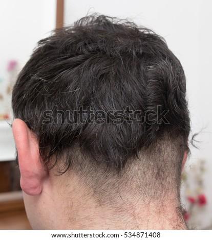 hairdresser cuts men's hair cut #534871408
