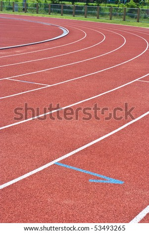 A university running track, around an football field. #53493265