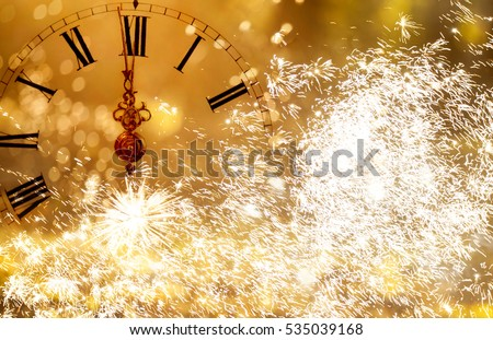 New Year's at midnight - Old clock with stars snowflakes and holiday lights #535039168