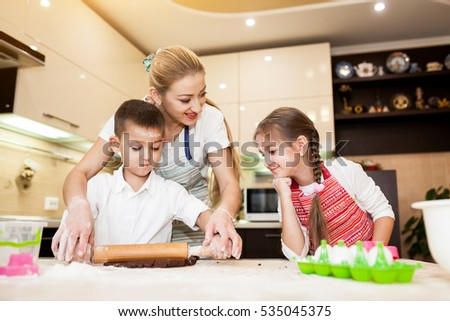family cooking in the kitchen #535045375