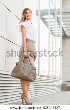 Portrait of smiling attractive confident young business woman #535046827