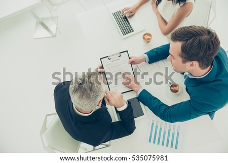 Top view of businessman pointing on one of the conditions of contract Royalty-Free Stock Photo #535075981