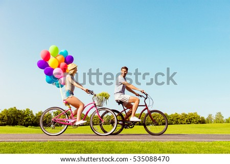 Happy family having summer weekend and riding bicycles. #535088470