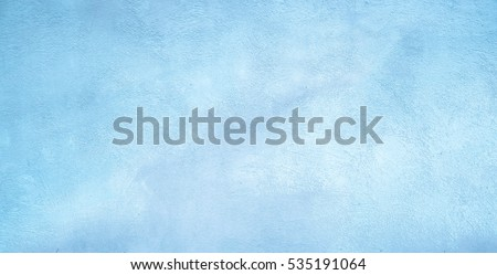 Abstract Grunge Decorative Light Blue Plaster Wall Background with Winter Pattern. Rough Stylized Texture Wide Screen With Copy Space for Design.  Royalty-Free Stock Photo #535191064