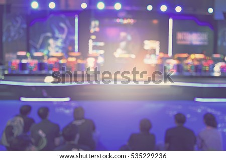 blur event with people background -  blurred computer game show festival  bokeh light vintage tone - business concept #535229236
