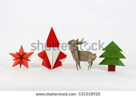 Christmas set. Santa claus, red star, deer and Christmas tree origami, paper craft #535358920