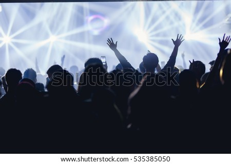 Effects blur Concert disco dj party new year People with hands up having fun #535385050