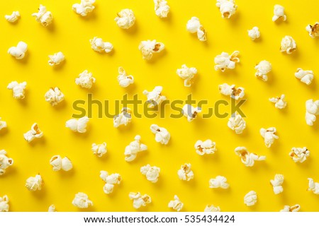 Popcorn pattern on yellow background. Top view Royalty-Free Stock Photo #535434424