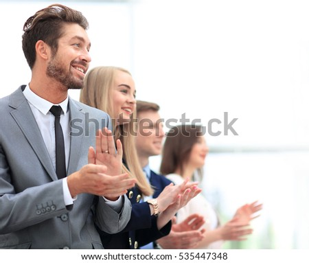 Satisfied proud business team clapping hands #535447348