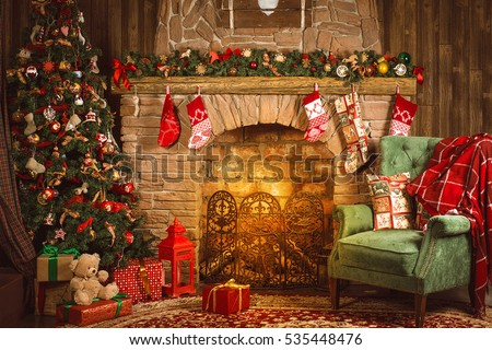 Christmas interior room fireplace, Christmas tree, green chair with a red blanket and gifts